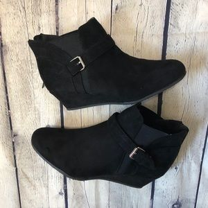 Black suede booties with side buckle